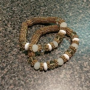 2 Gold and white stretchy beaded bracelet.